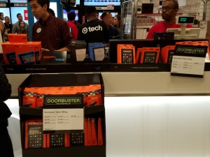 Amazon device display at Target shoing Fire TVs and Fire TV Sticks